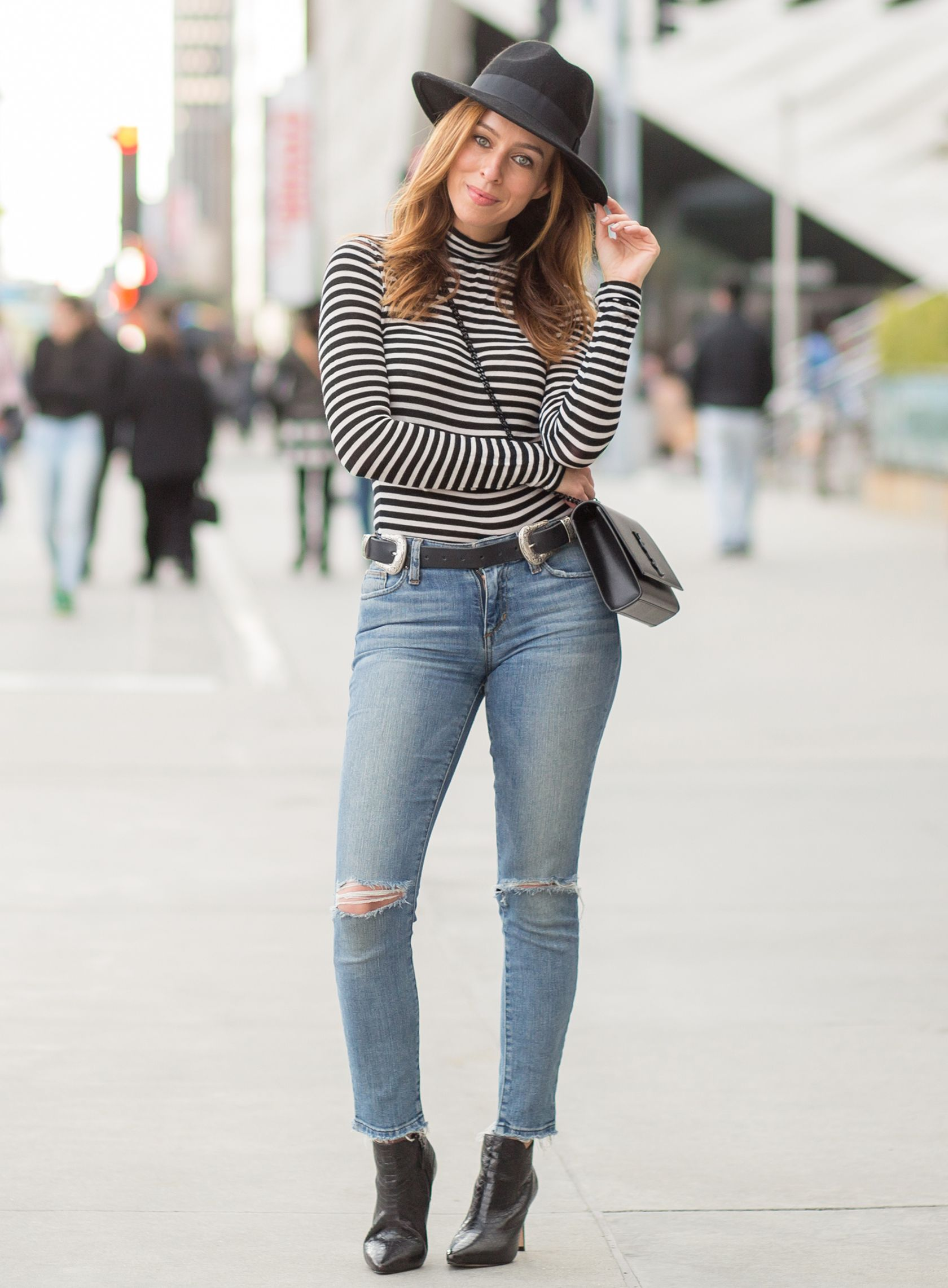 Los Angeles fashion blogger Sydne Summer street styles Day to Night in a  Striped Turtleneck and Jeans. Shop the look online! 988ba1674f