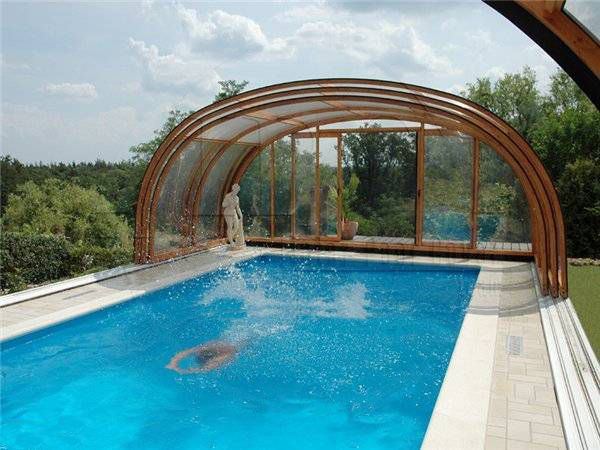 Indoor swimming pools and pool enclosures add luxury to for Pool exterior design