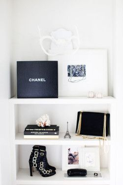 what i'll be putting on my shelves. chanel books you can find on amazon. you can make this shelf corner the staple piece in a small room!