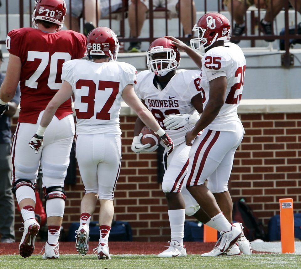 Ogbonnia Okoronkwo (82) is congratulated after taking an interception to the two yard line during the Spring College Football Game of the University of Oklahoma Sooners (OU) at Gaylord Family-Oklahoma Memorial Stadium in Norman, Okla., on Saturday, April 12, 2014.  Photo by Steve Sisney, The Oklahoman