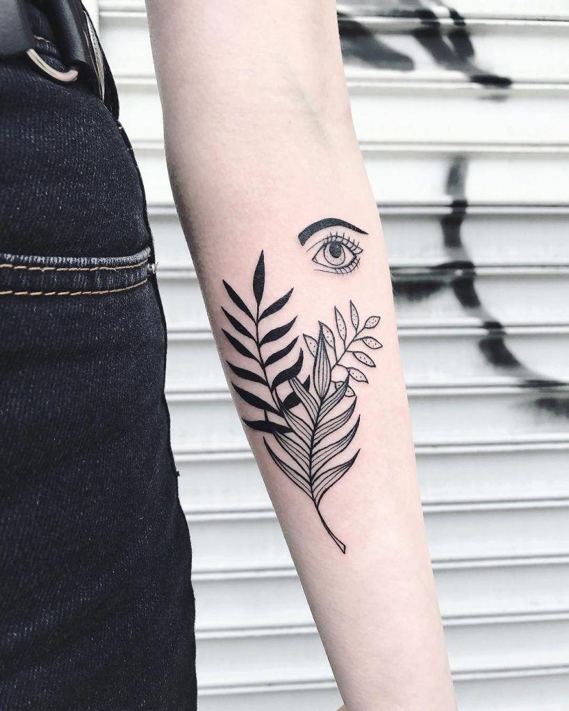 Black palm tree leaves and eye tattoo Black fern leaf