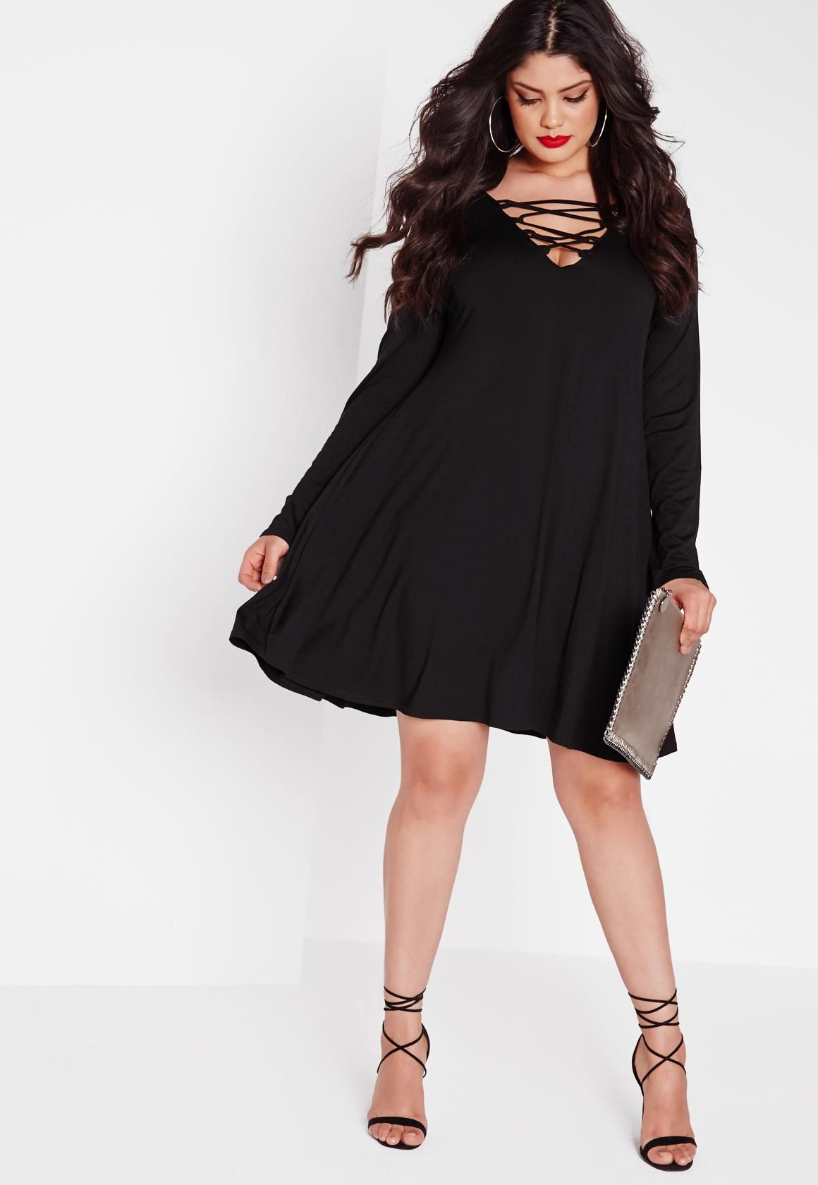 5b450f2b82 Lace up deets are what we love here at Missguided and this black swing dress  with long sleeves and lace up feature to the front is perfect day or night!