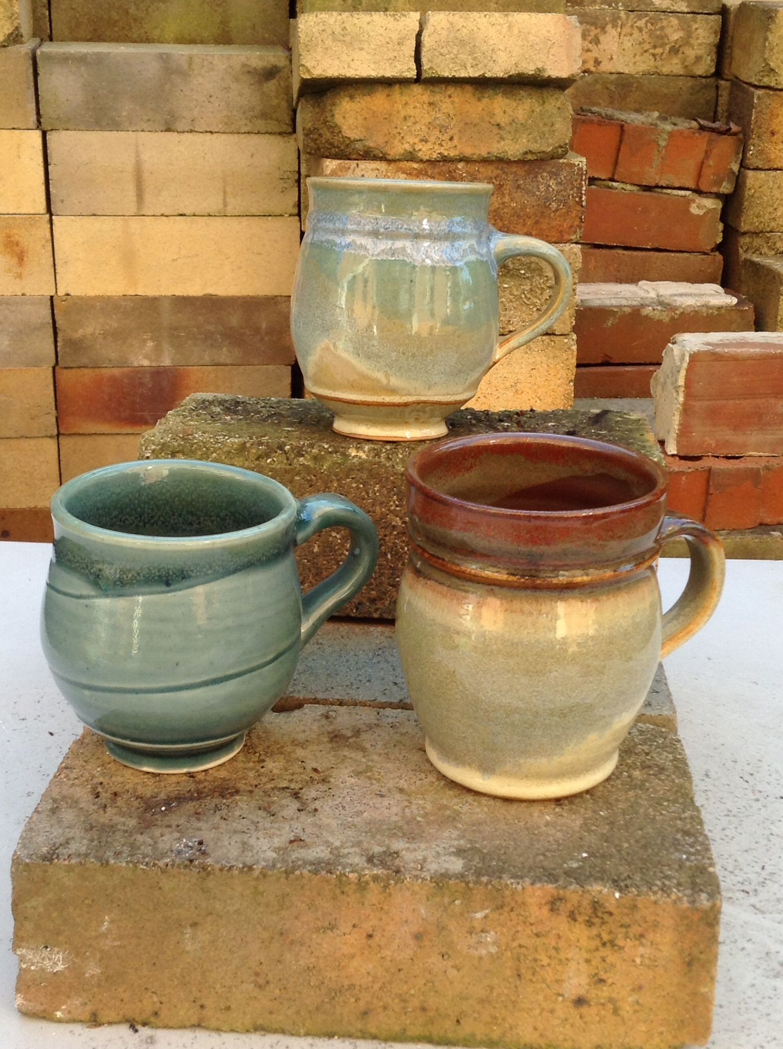Mugs from the last firing.  Cone 6 oxidation.