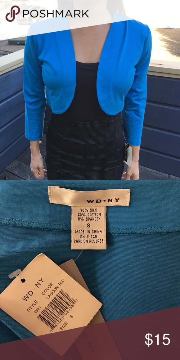 NEW silk shrug New with tags blue shrug. 70% silk. Beautiful for formals, work, or everyday! WD.NY Sweaters Shrugs & Ponchos