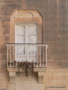 Malta ...Balcony doors white plant drapping over edge sandstone smoked roof & door ... Malta ...Balcony doors white plant drapping over edge ...