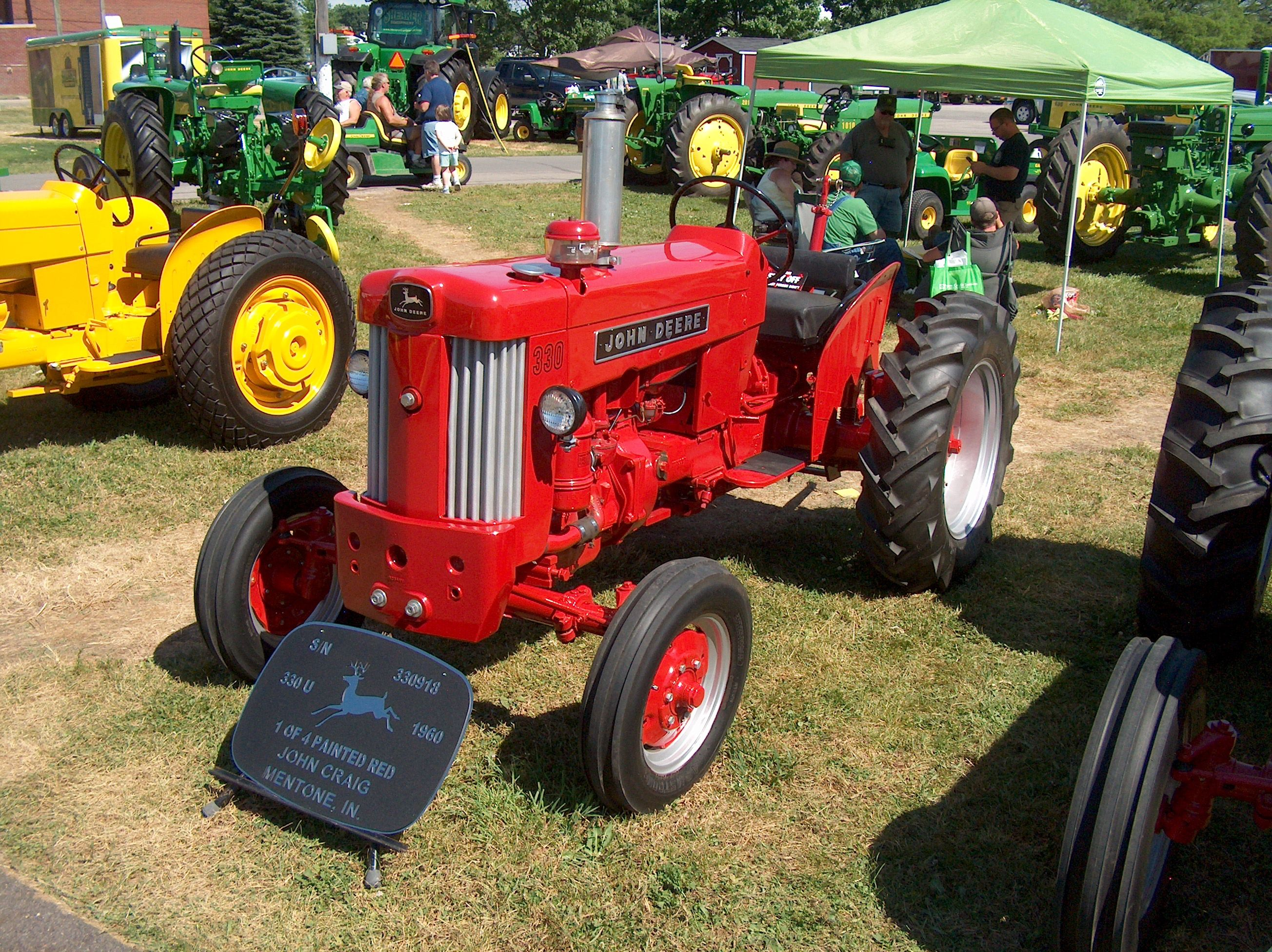1960 John Deere 330U painted red at the factory for the Ohio Highway Dept.