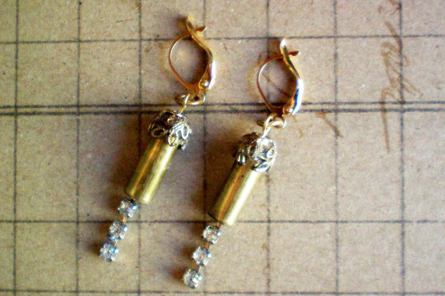 Steampunk bullet casing and rhinestone chain drop earrings. Recycled and ONE OF A KIND. $10.00, via Etsy.