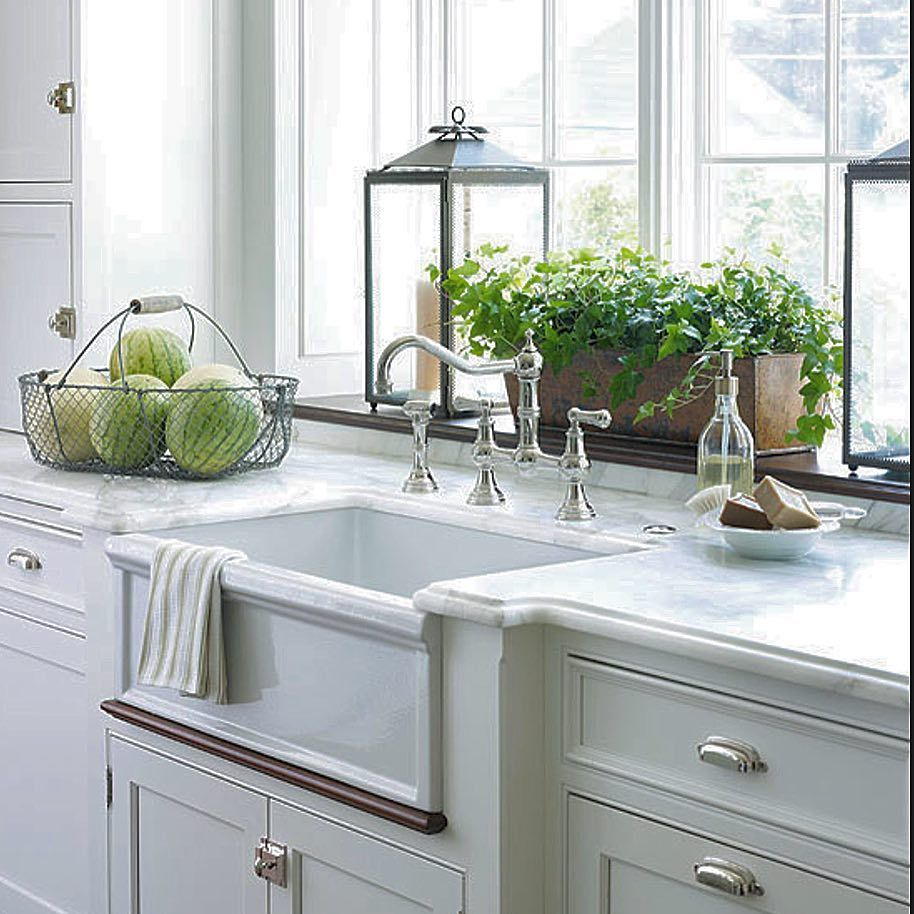 Just a white kitchen with a simple farm house sink