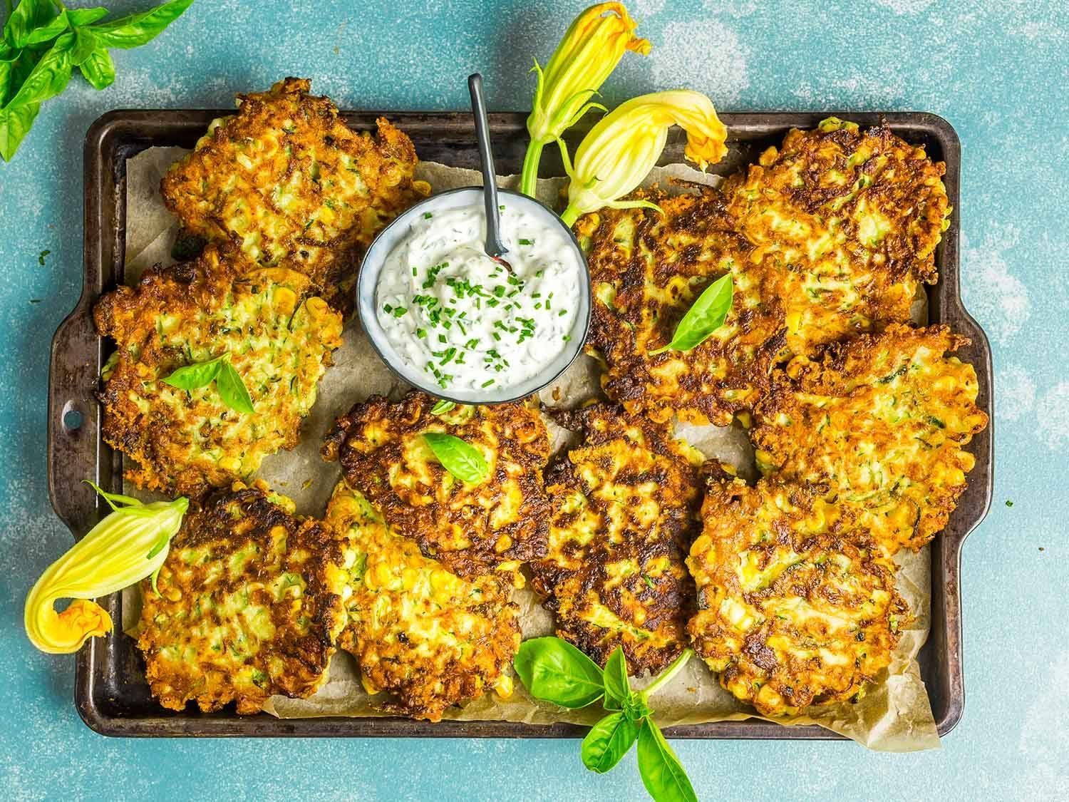 Zucchini And Corn Fritters With Herb Sour Cream Recipe Recipe Sour Cream Recipes Fritters Serious Eats