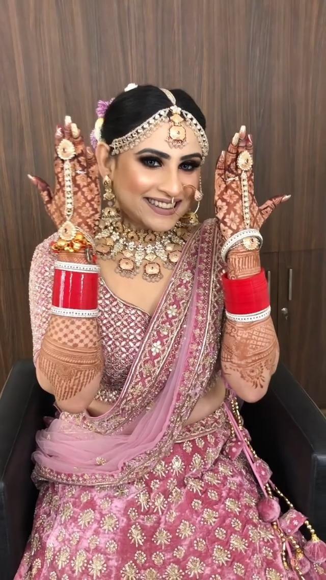 Pink and silver bridal lehenga.