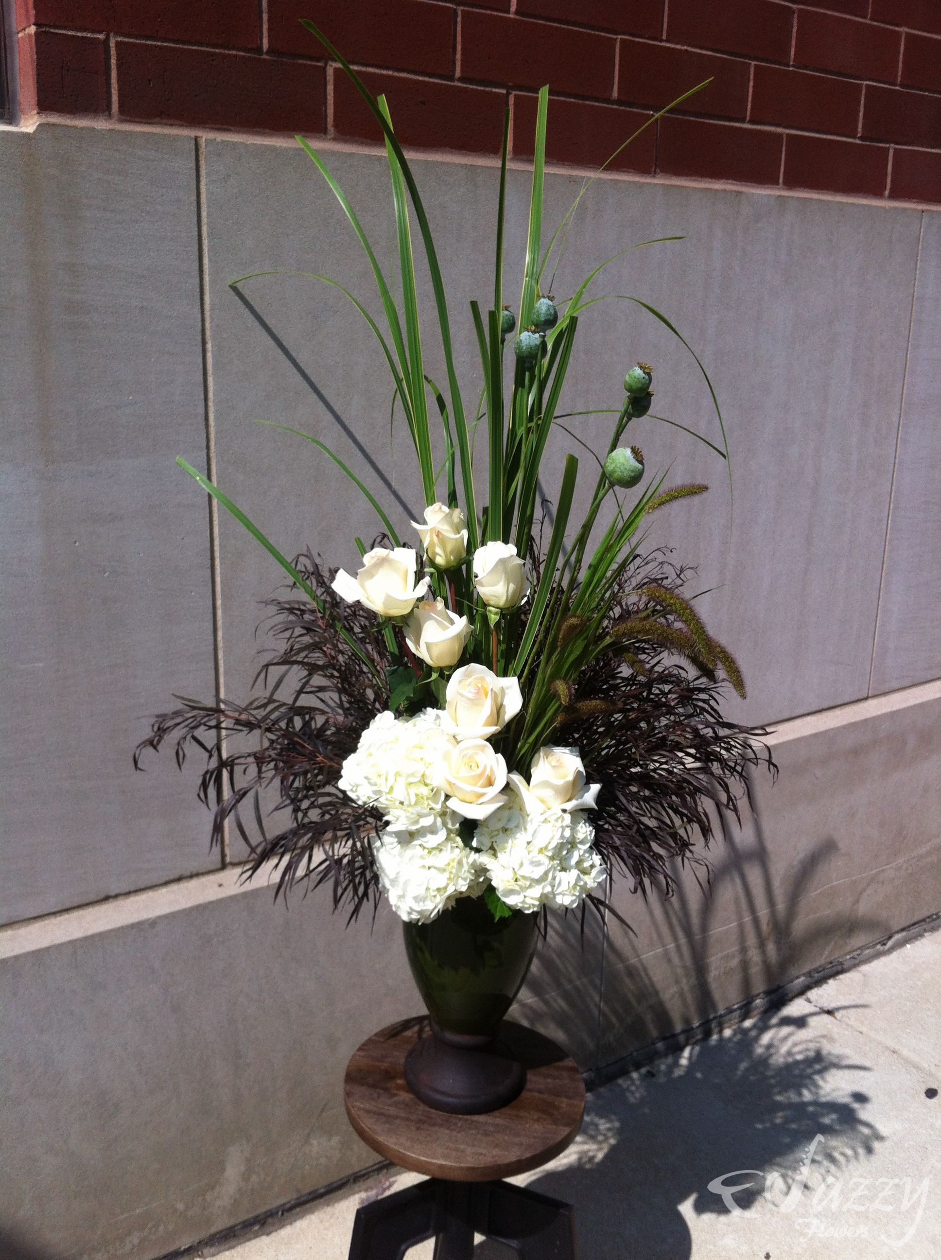 roses, hydrangea, grasses, agonis, poppy pods Poppy pods