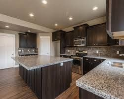 Sarsaparilla Maple Cabinet And New Caledonia Granite Google Search Caledonia Granite Home Kitchens Kitchen Redo