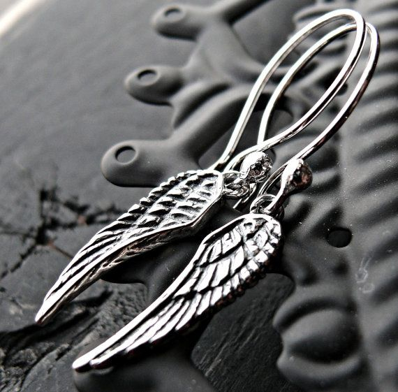 Beautifully detailed sterling silver dangle earrings  Each Angel wing measures: 2 1/2 long from top to bottom  Hung on sterling silver artisan
