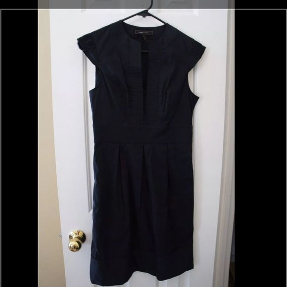BCBG office wear size XS, stylish and elegant This beautiful dress is work appropriate and stunning for a night out. I am 5'3 and it hits slightly above my knee. BCBGMaxAzria Dresses Midi