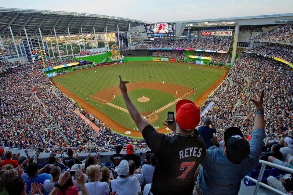 Fans attend opening day at Marlins Park on Wednesday