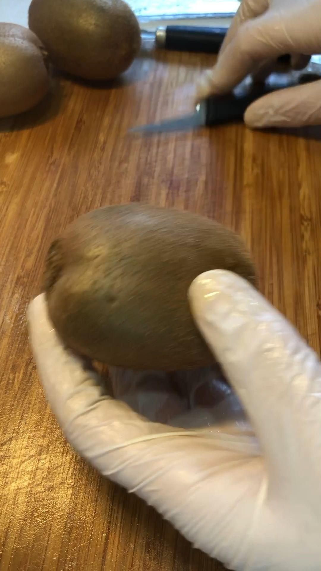 Carving a flower from a kiwi