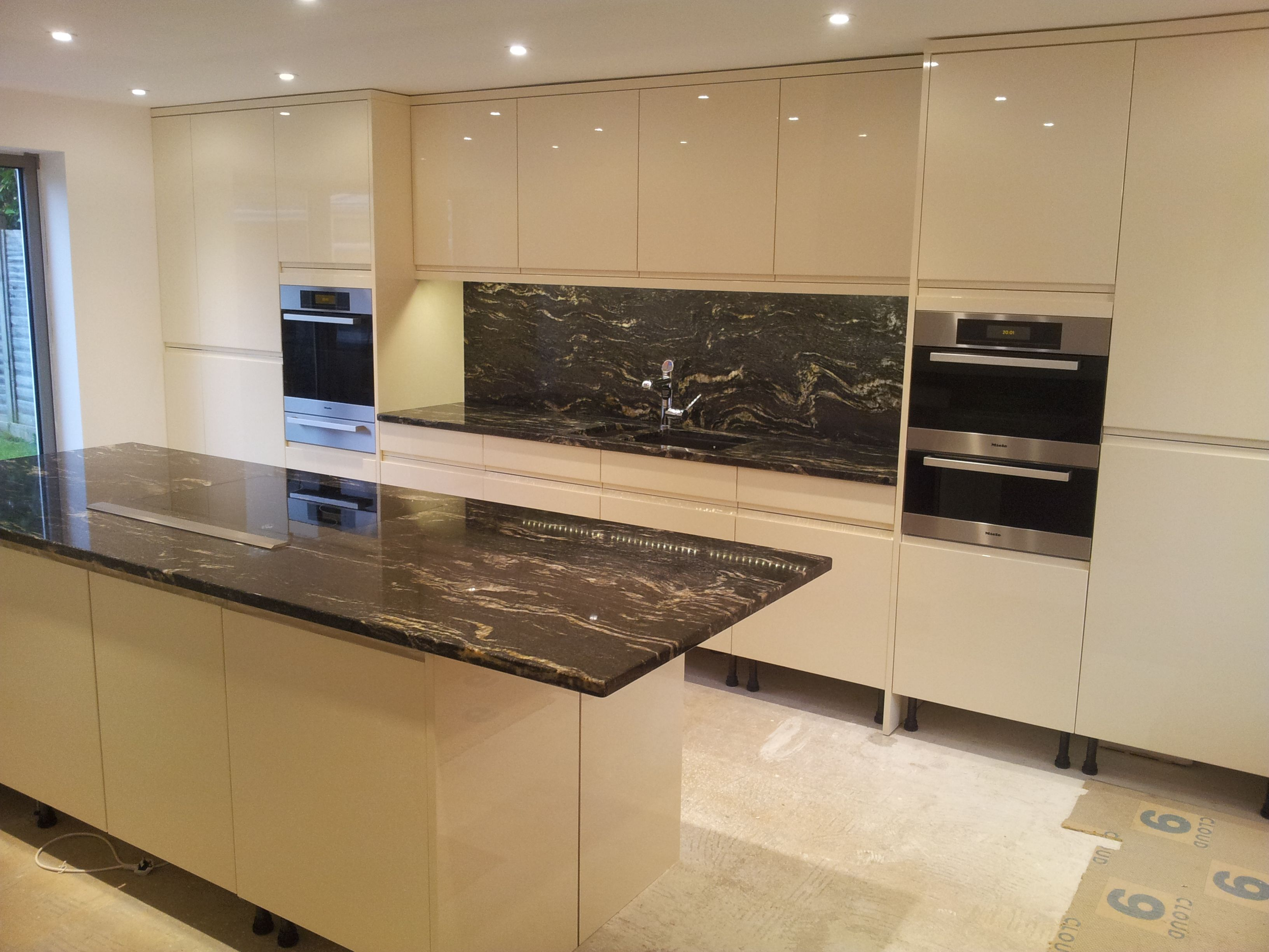 White Kitchen Black Benchtop cosmic black granite worktops installed in frampton cotteral