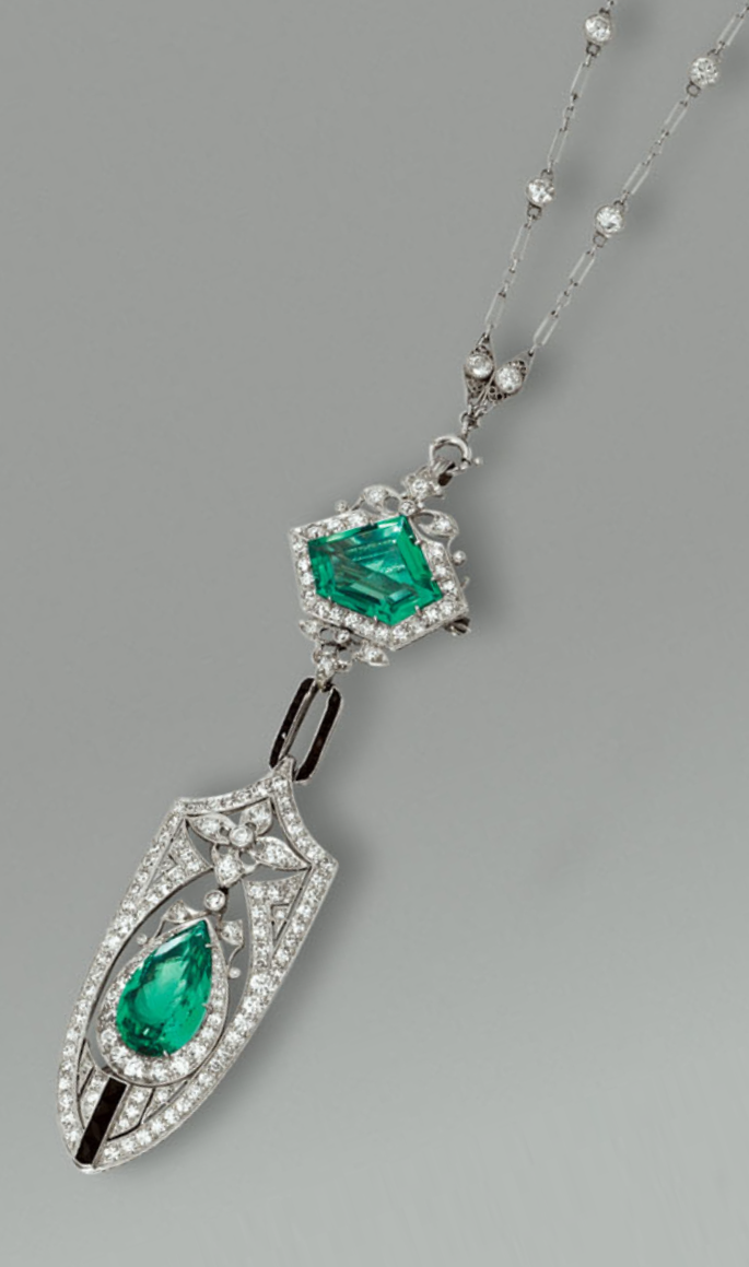 A belle epoque emerald black onyx and diamond pendent necklace