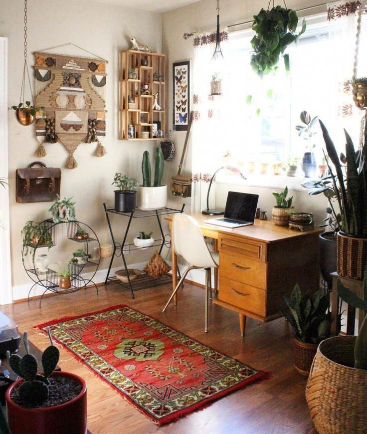 Would you work in this boho home office? What we love most about this space is that it's not just boho but also a little chic. I guess you can call it a chic boho home office. When it comes boho home office plants, Always try to add at least 3 indoor plants that doesn't need sun to your space. #homeofficedecor #homedecorlove #workfromhomemom #boholife #bohohomedecor