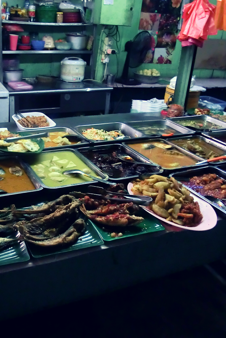 Variety of curries in Kualalumpur, Malaysia. Found in a small Street Food market.