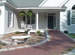 Aesthetically pleasing wheelchair ramps to the front door for Garden design ideas for disabled