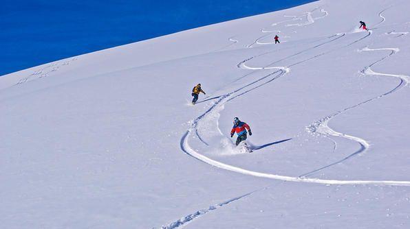 Switzerland- Bert and his travelers snowboard through fresh powder on Petersgrat Mountain in Switzerland.
