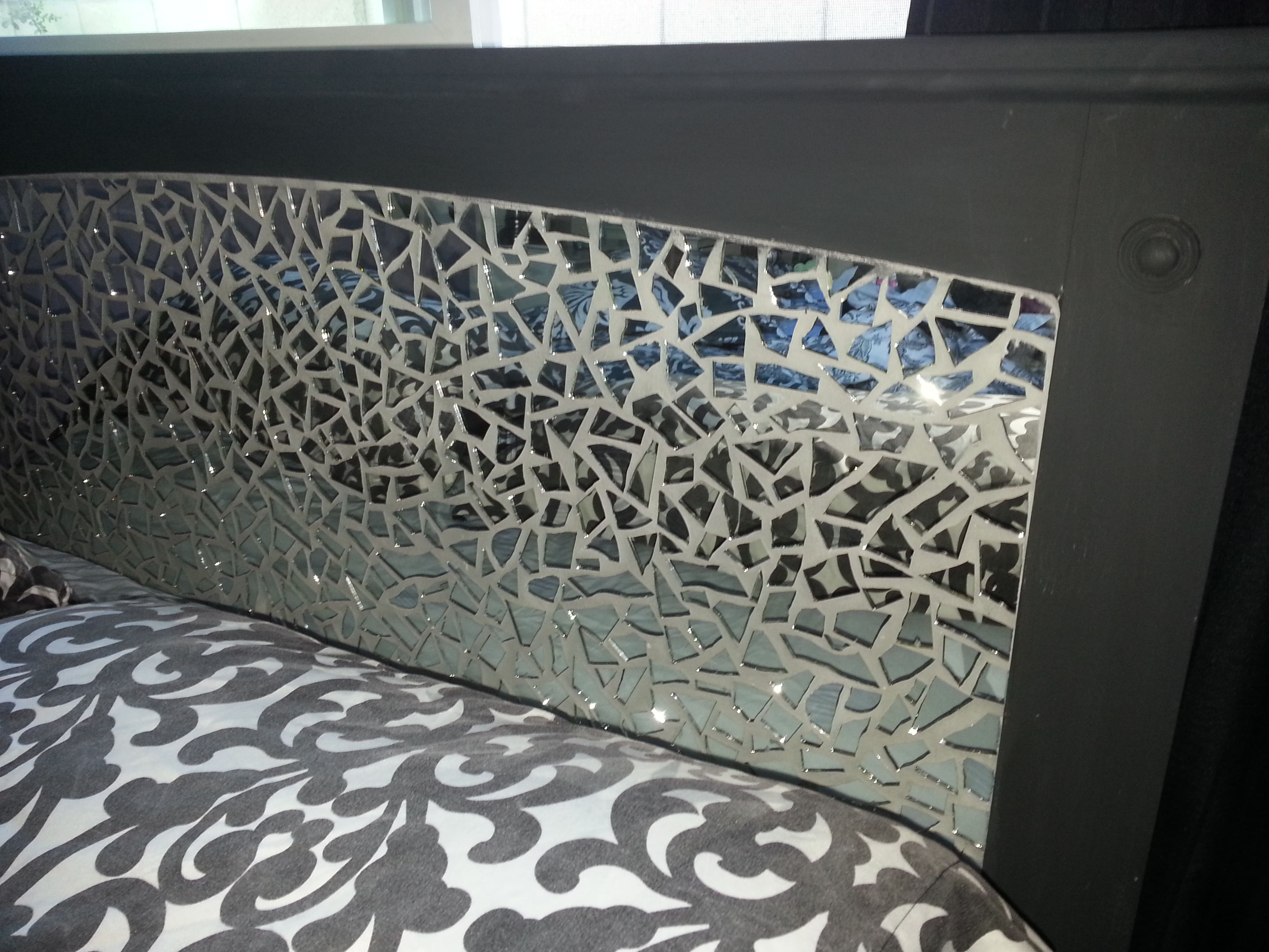 Headboard which started out as  a simple country style frame. Filled in with foam board and then covered with mirror mosaic pieces.