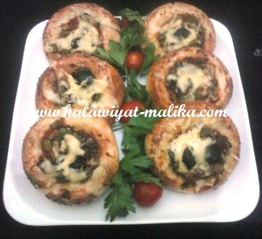 خبيزات بحشوة البيتزا كالقطن ولا أروع لأختكم مليكة المقادير والطريقة بالصور في هذا الرابط: http://www.halawiyat-malika.com/2015/05/blog-post_40.html