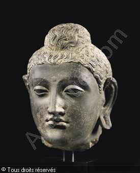 Image from http://www.artvalue.fr/photos/auction/0/54/54402/gandhara-ier-iiieme-afghanista-tete-de-bouddha-shakyamuni-3520779-500-500-3520779.jpg.