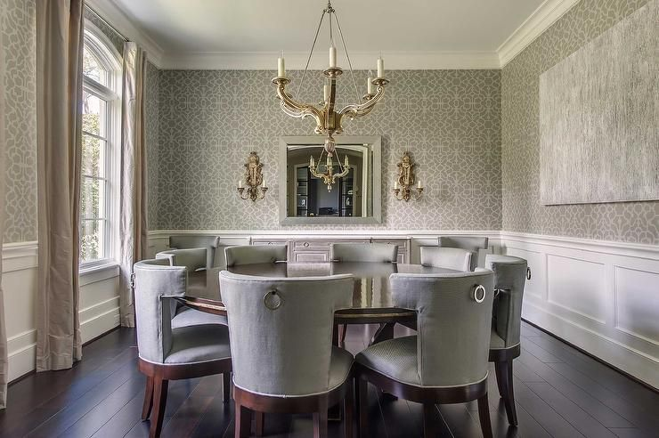e94d2e11eb76 Grey dining room features upper walls clad in gray trellis wallpaper and  lower walls clad in wainscoting alongside a chandelier illuminating an  expansive ...