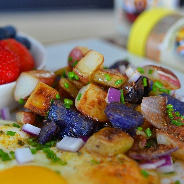 """""""#flavorgod CRISPY rainbow POTATOES , eggs and fruit.  For crispy potatoes I parboil before I roast in oven or pan fry.  Here's my technique.  Cut potatoes…"""""""