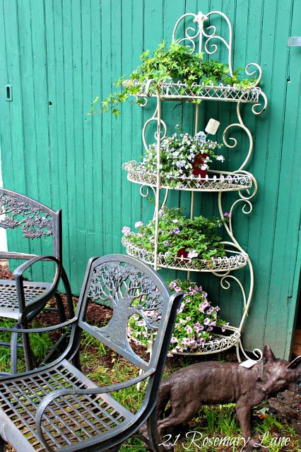 metal plant stand - use an old baker's rack to hold plants