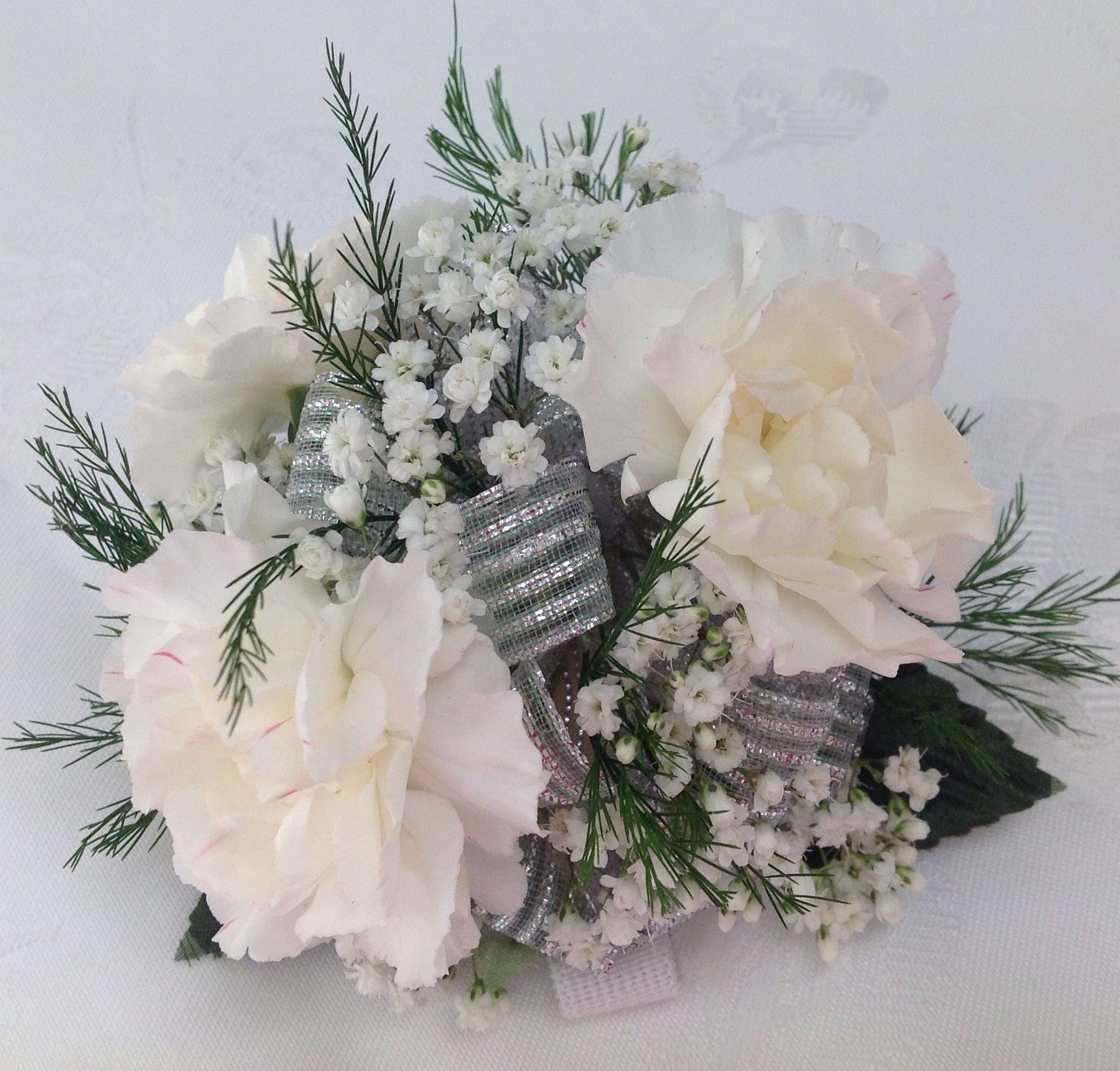 Carnations making a comeback with silver add a keepsake bracelet.