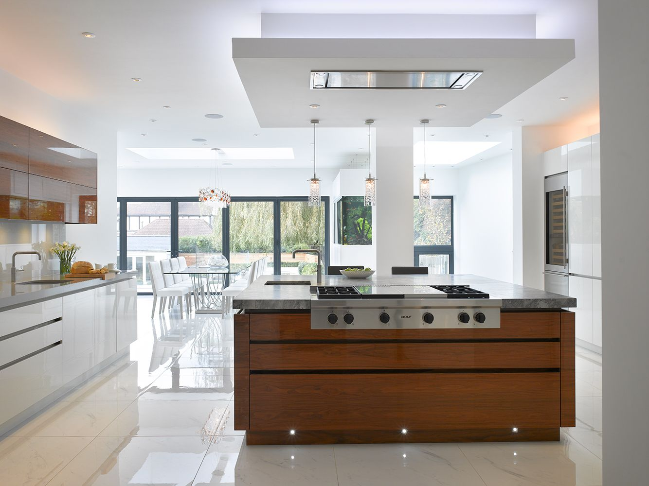 Roundhouse urbo high gloss white lacquer bespoke kitchen with book