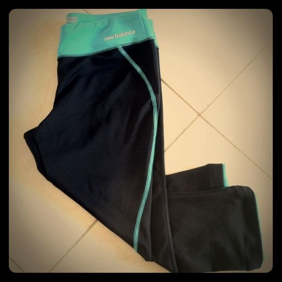 NEW BALANCE workout black/teal blue capris NEW BALANCE black Capri workout athletic pants with teal accents on waist and piping down the leg. Very cute New Balance Pants Capris