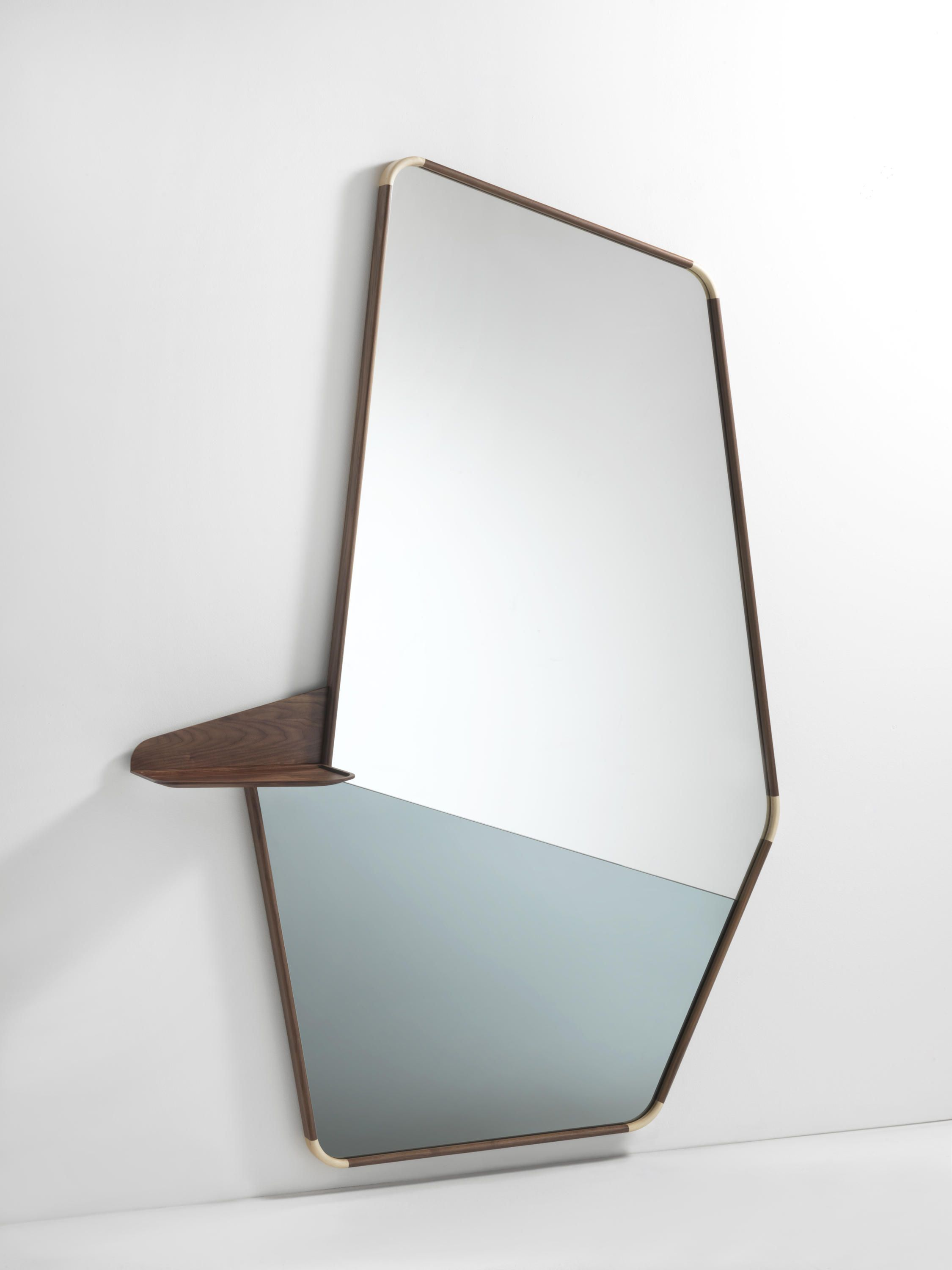 Multifunctional items and large mirrors are created to personalize the  interiors, like the Ops mirror