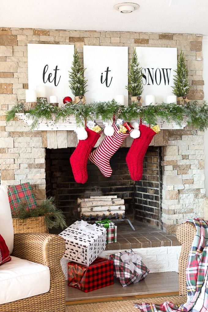 christmas mantel decorating with greenery and lettering on large canvases christmas mantel decorating with greenery