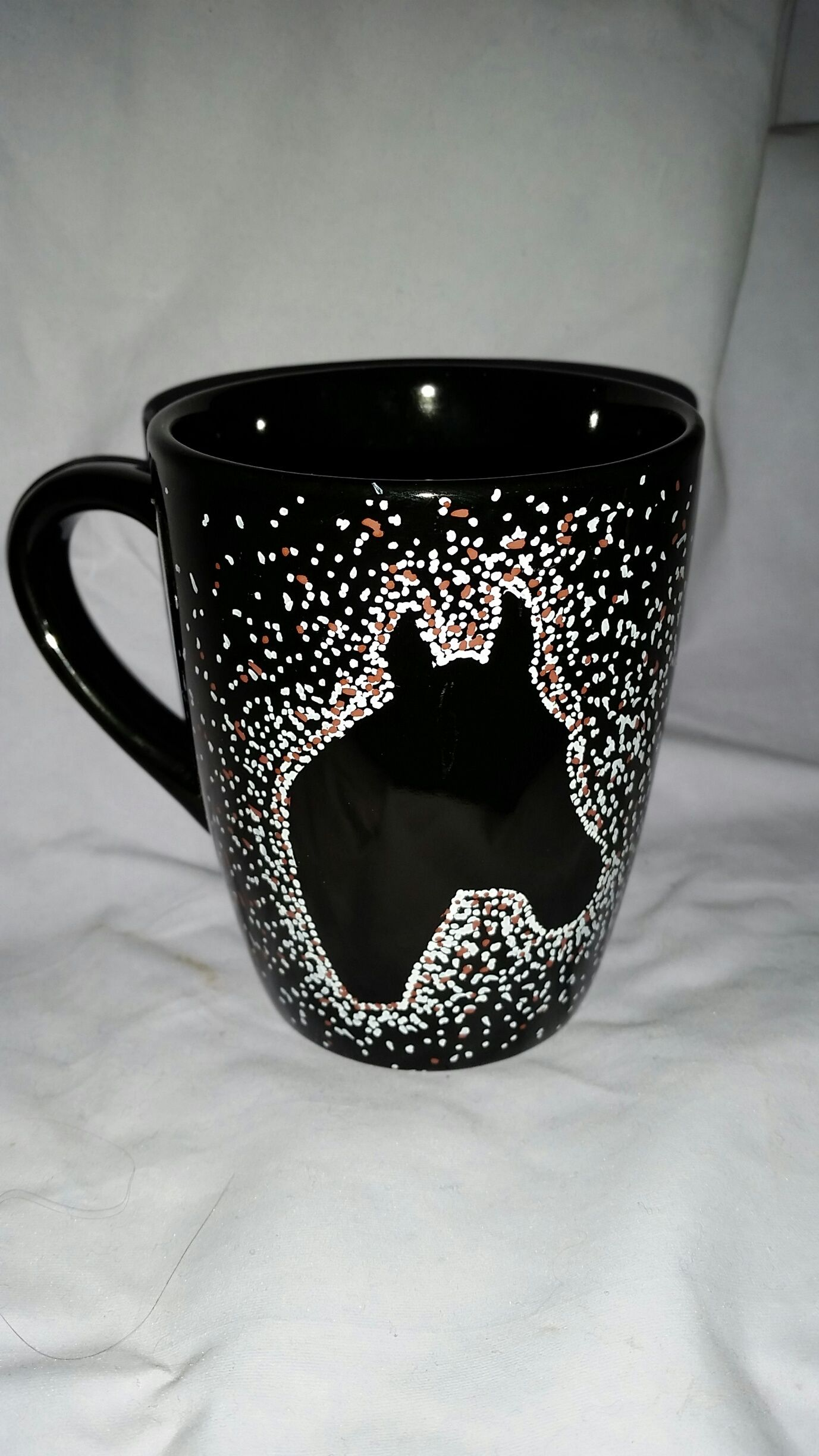 Hand Painted ceramic mug with dot painted silhouette of a