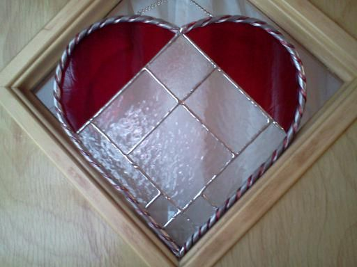 Textured glass with bevels; twisted caming with colored wire trim for valentines day.