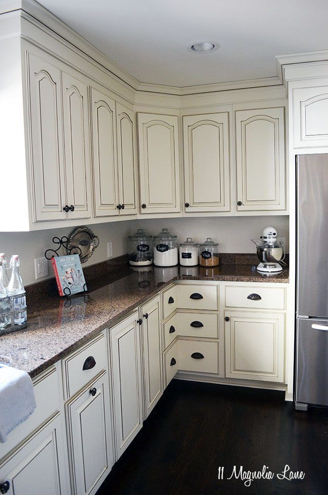 French country kitchen with off white cabinets and