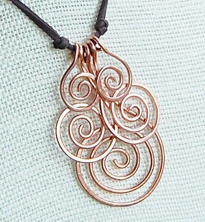 I'm going to make this in silver spirals. Instead of leather I'll use silver chain. To replace knots I will use a glass bead on either side.