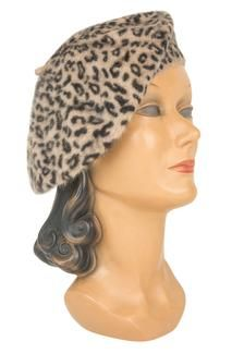 Leopard Beret: This beige Leopard Beret is a soft and sweet way to show your wild side! This classic, vintage-inspired hat brings a touch of Parisian elegance to your look with soft spotted felt. The warm neutral colors pair perfectly with a variety of Trashy Diva dresses for a cold weather look you'll adore! #trashydiva