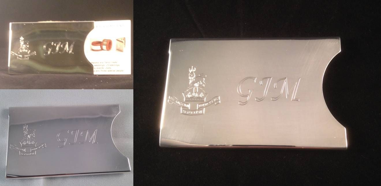 Hallmarked sterling silver business card case, hand-engraved with a ...