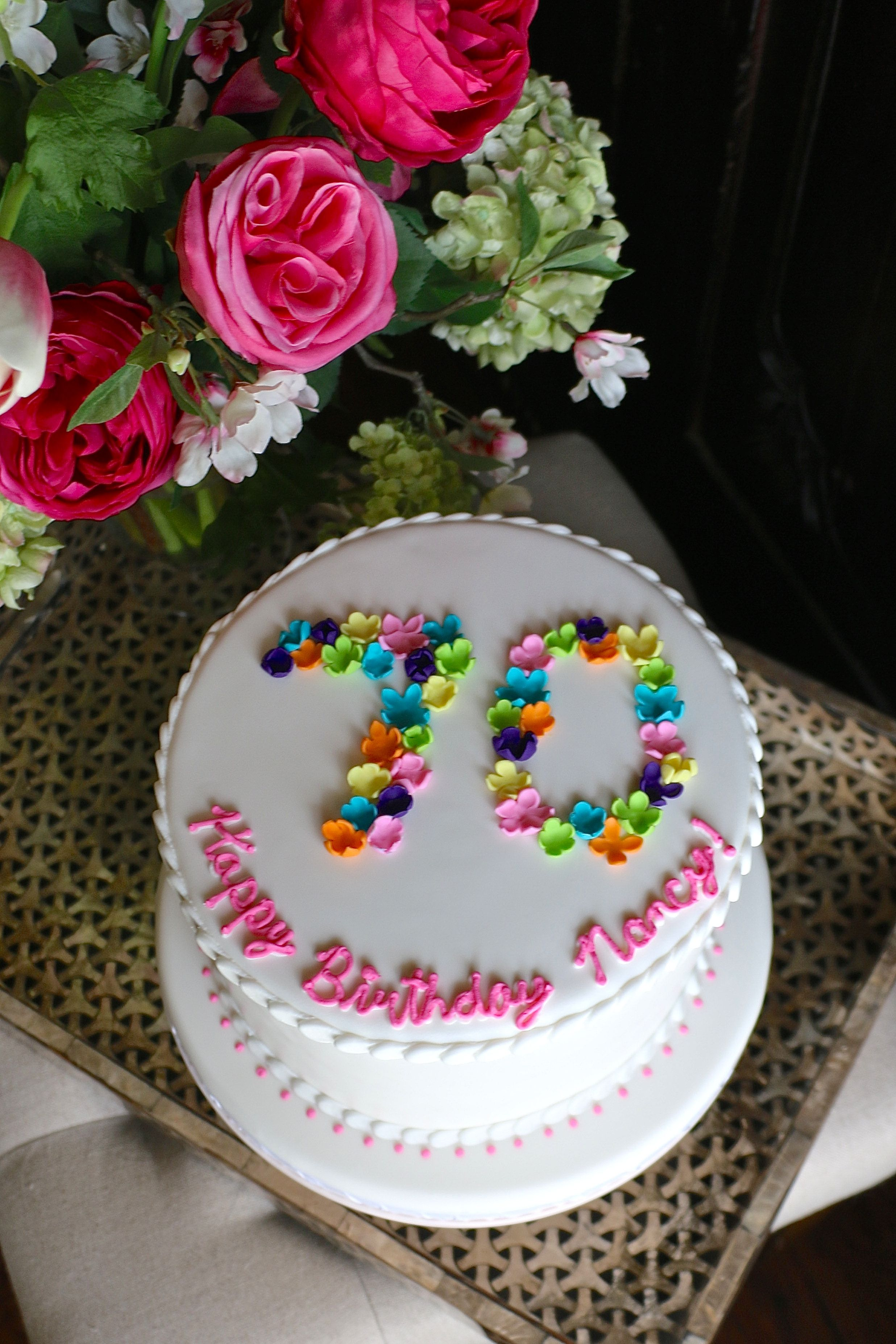 Bright flowers 70th birthday cake by taylor made sweets