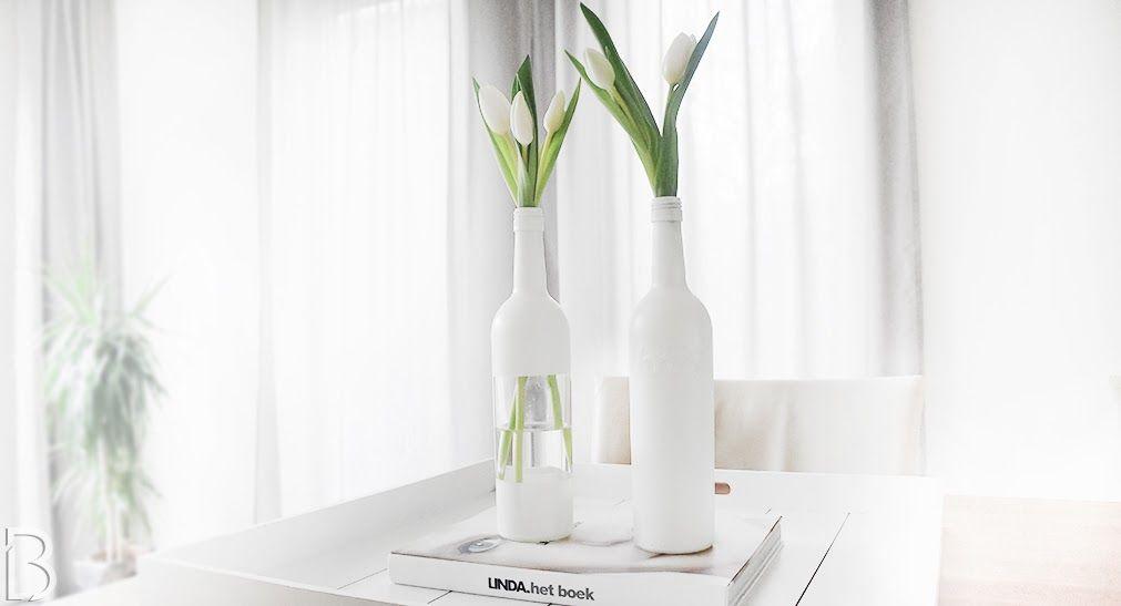 llittleblonde: DIY | MATTE BOTTLES Gorgeous vases made of wine bottles. The bottles are spray painted with white matte spray paint. Use a little tape to create a transparent part. #vases #winebottle #diy #tulips #whitetulips #allwhite #green #flowers #whitevase #mattewhite