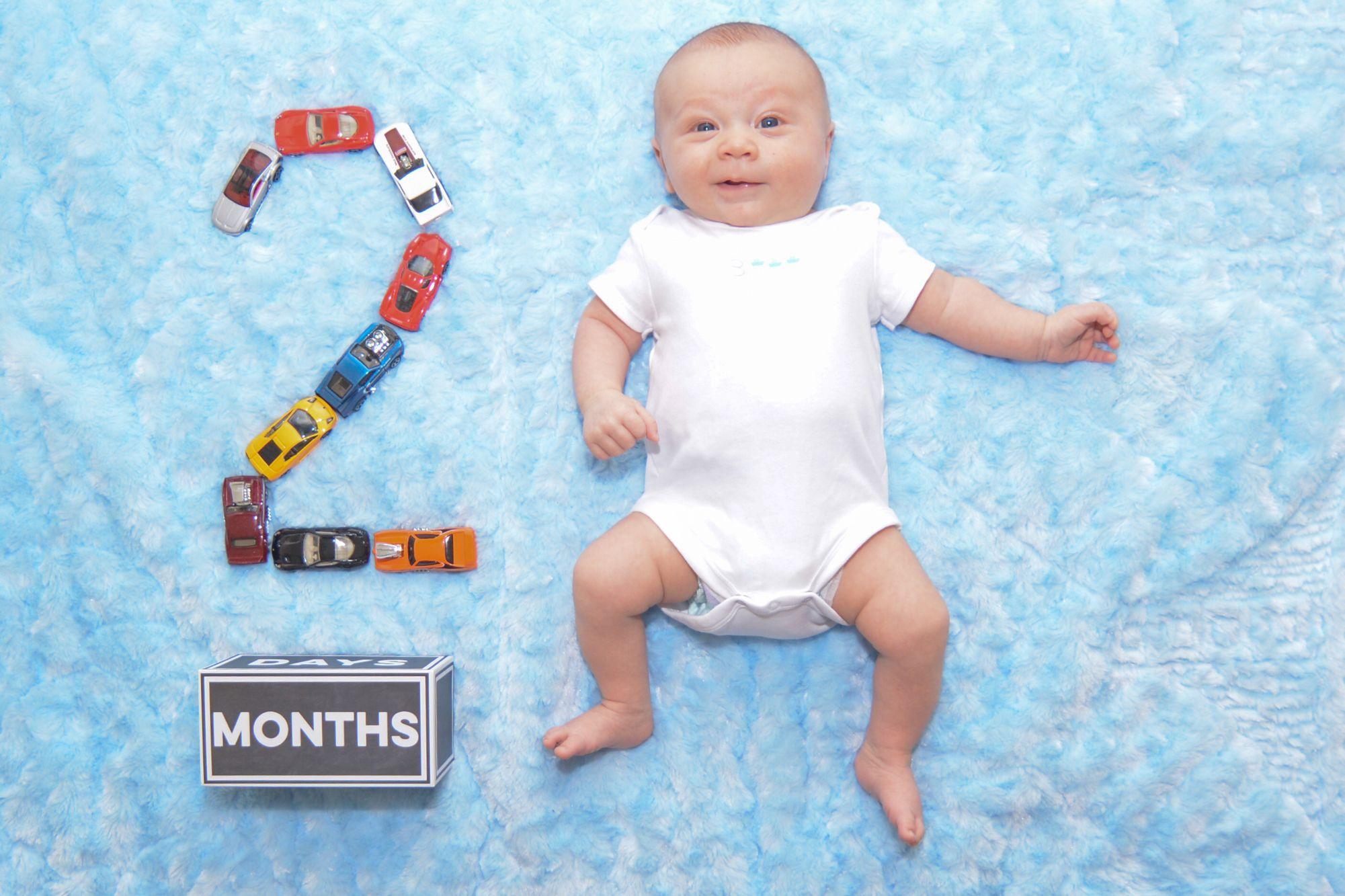 2 month baby photo race car photography newborn photoshoot