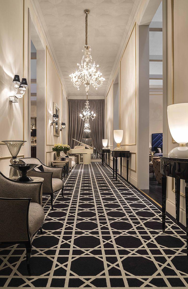 Striking design!  #design #flooring #interior #style #black #white #hallway #chandelier
