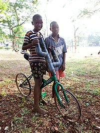 """""""Children play – across the entire world and in every social class. In Mombasa's slums we can see just how little they need for play: they can run through the streets for hours with an old tyre, keeping it rolling and chasing it through the alleys and around the squares."""""""