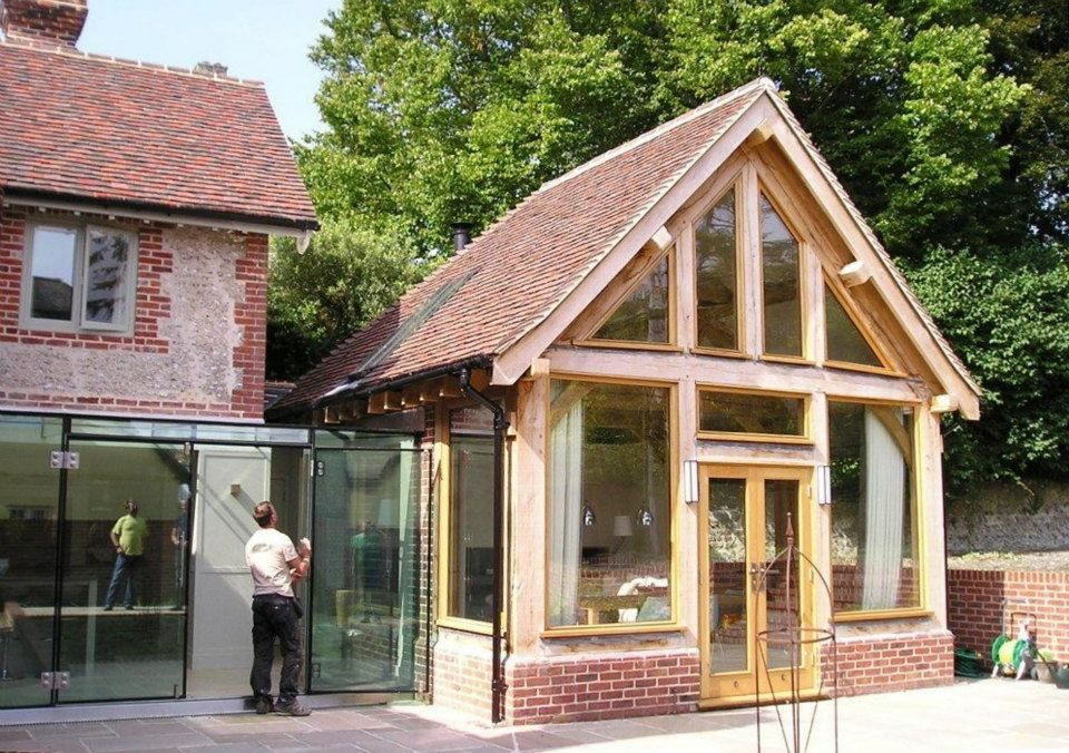 Oak framed garden room with modern glass link to existing for Oak framed garden room