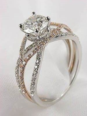 This band (or just three bands intertwined) with a cushion cut diamond and  halo
